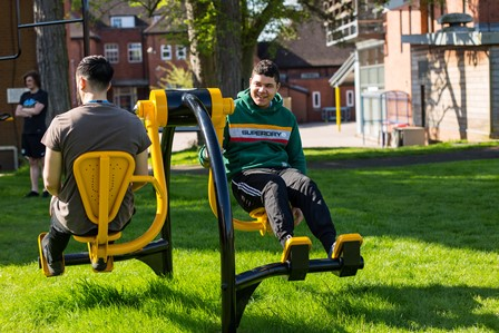 QAC student uses outdoor gym area