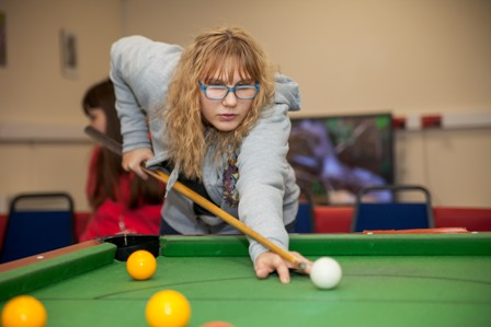A student plays Pool in our Student Centre