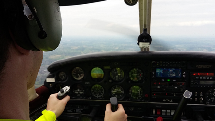 Bobby in control of the aircraft during his flying lesson