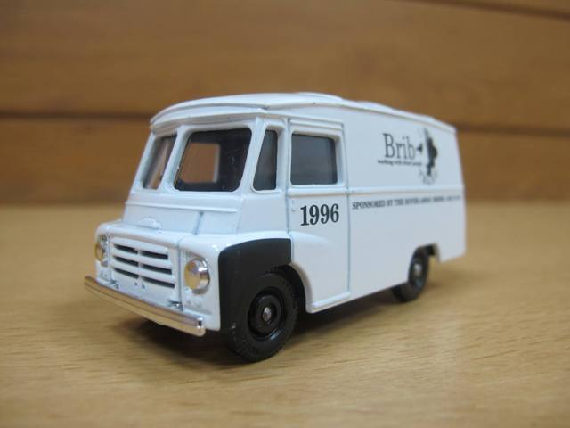 A front view of brib die-cast model van out of box