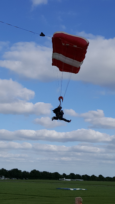 A Skydiver about to land from their jump