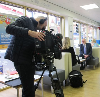 BBC cameraman films Sandwell Councillor Bob Piper and BBC Special Correspondent Katie Razzall in  Coffee Junction - Aug 2015