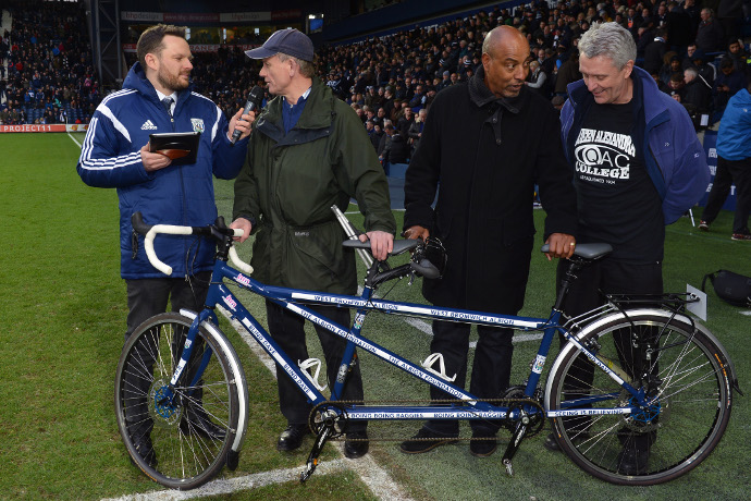 Blind Dave being interviewed pitch side behind his Tandem Bike