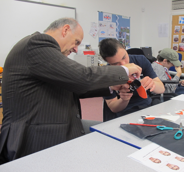 QAC Principal Hugh Williams working with student during WE Week exercise by Hobbycraft