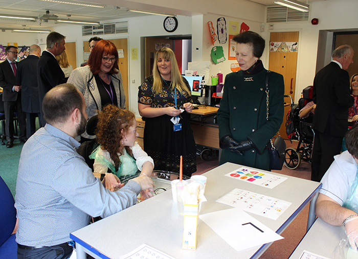 HRH The Princess Royal speaking to a student during her visit to PFL Black's classroom