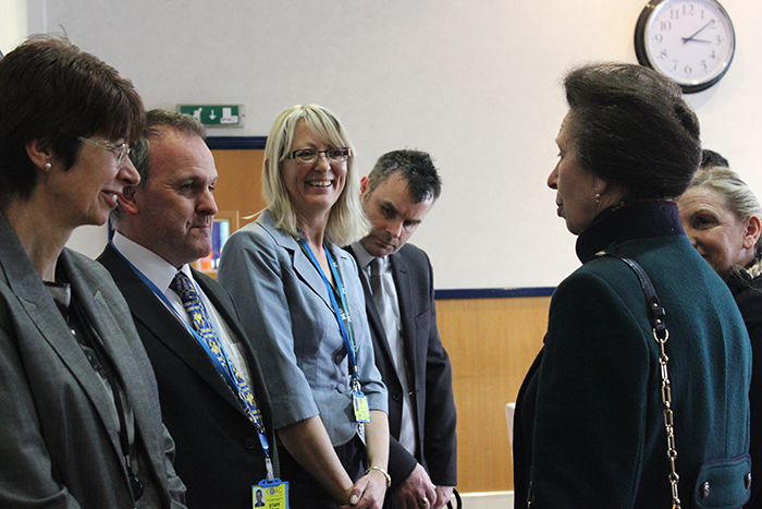 HRH The Princess Royal speaking with some of QAC's long serving members of staff