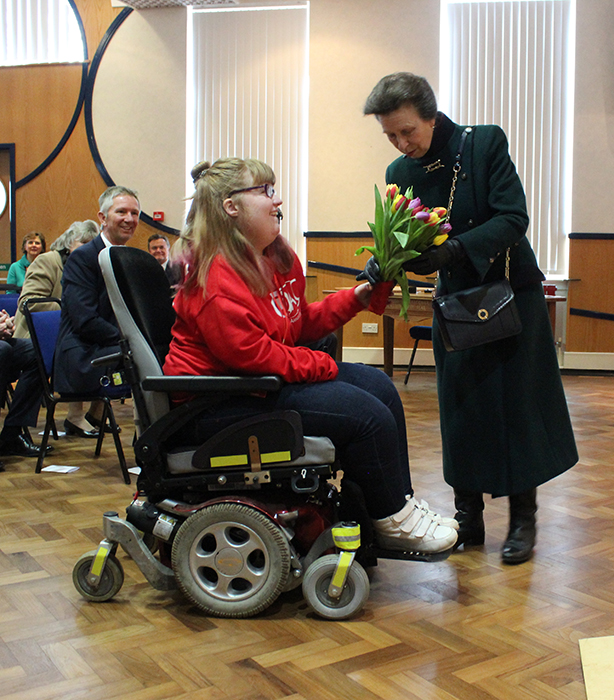 QAC Student Ambassador Hannah presenting HRH The Princess Royal with a bouquet of flowers