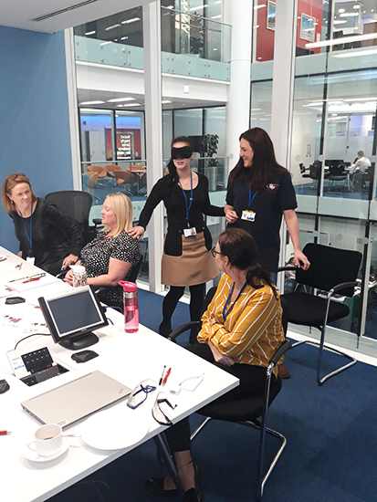 Rehab and Travel Training officer Emma teaching Barclays staff some Sighted Guide techniques