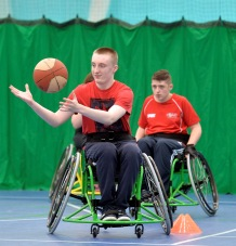 QAC student participating in wheelchair basketball