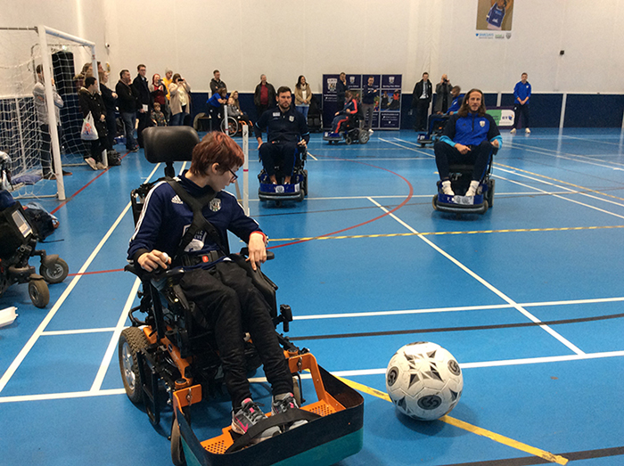 Powerchair Football student Amy in a game against West Bromwich Albion footballers