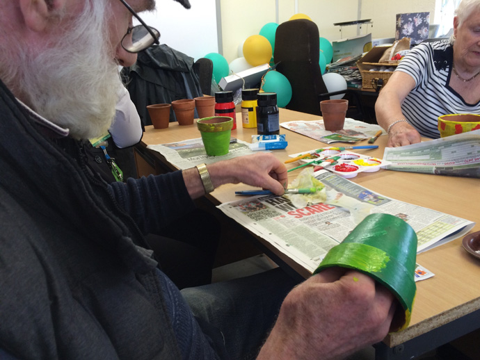 Members of the group decorating plant pots during the Dementia workshop