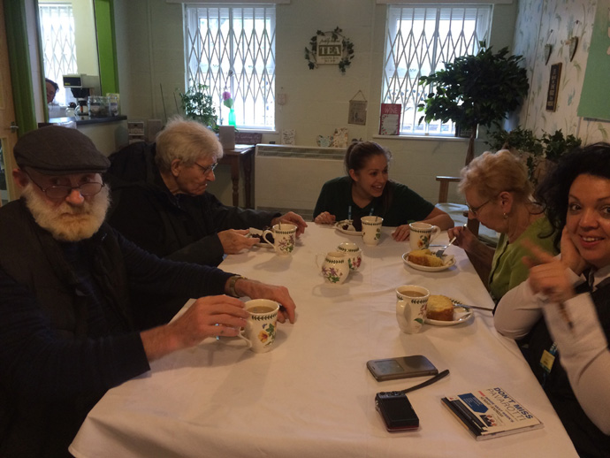 The group enjoying tea and cake at the Dementia workshop