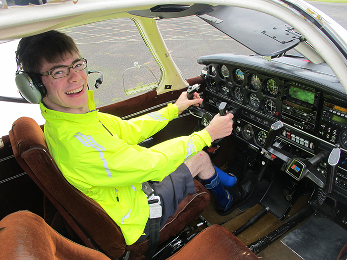 Bobby behind the controls of the plane, before his flying lesson.
