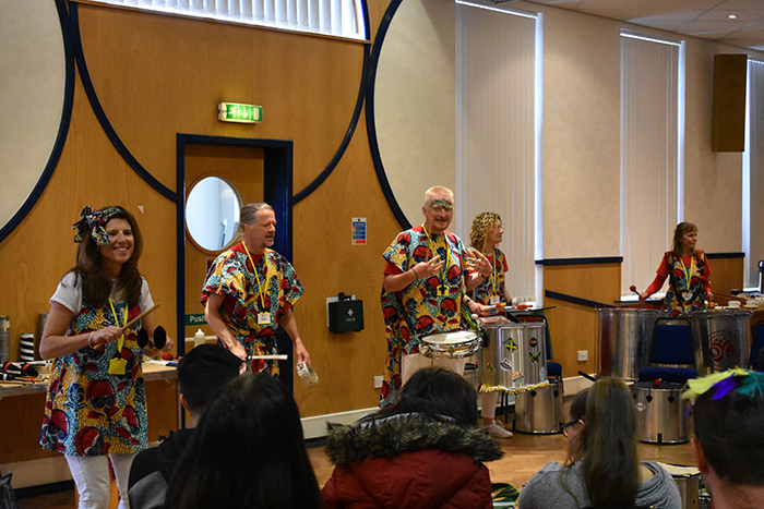The Oya Batucada samba band giving a samba music demo to students