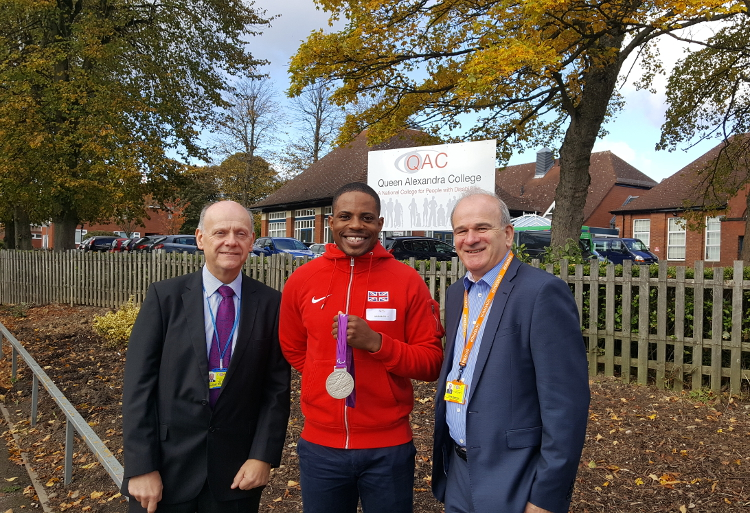 QAC Principal Hugh Williams, QAC Chair of Governors Chris Bradshaw and QAC Patron Mikail Huggins posing for photo