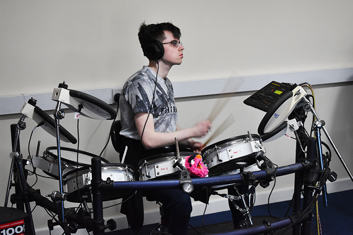 QAC student recording drums for the music piece