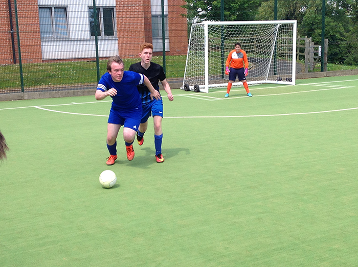 2 football players going head to head for the ball during the Natspec games