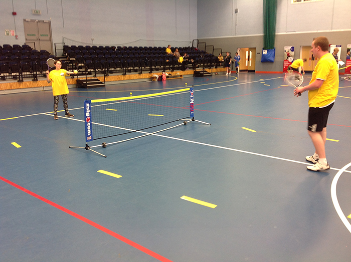 QAC tennis players Eve and Adam practicing at the Natspec games