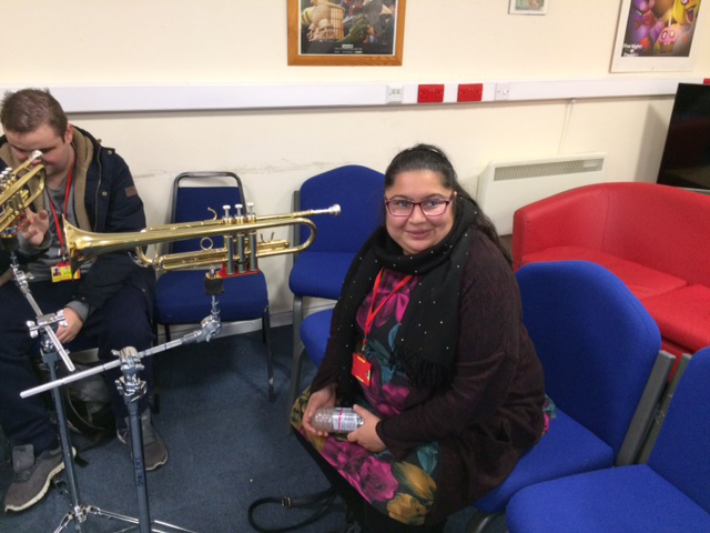 QAC student getting ready to play a piece of specially adapted music equipment