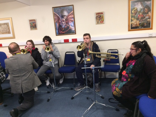 QAC Students using specially adapted music equipment