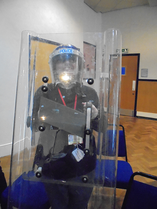 Another QAC student happy to try on Police riot gear