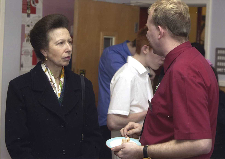 HRH The Princess Royal speaking to a QAC member of staff during her 2004 visit