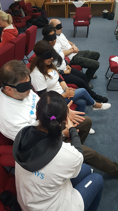 Barclays staff take part in a blindfolded activity with the mobility team