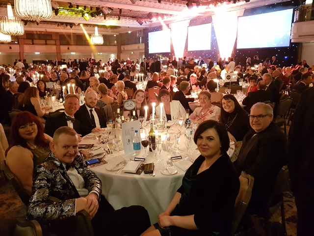 QAC staff sit around a table at the Tes FE Awards ceremony