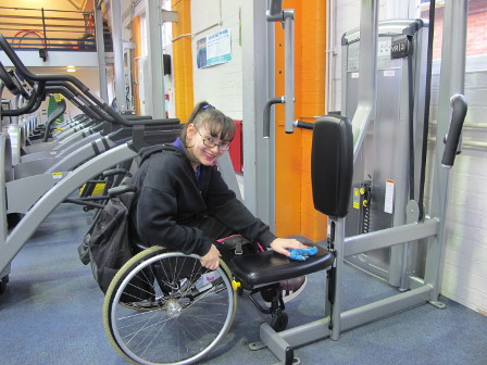 /media/news/library/qac-student-kerri-cleaning-equipment-on-her-work-placement-at-feelgood-fitness-centre.jpg