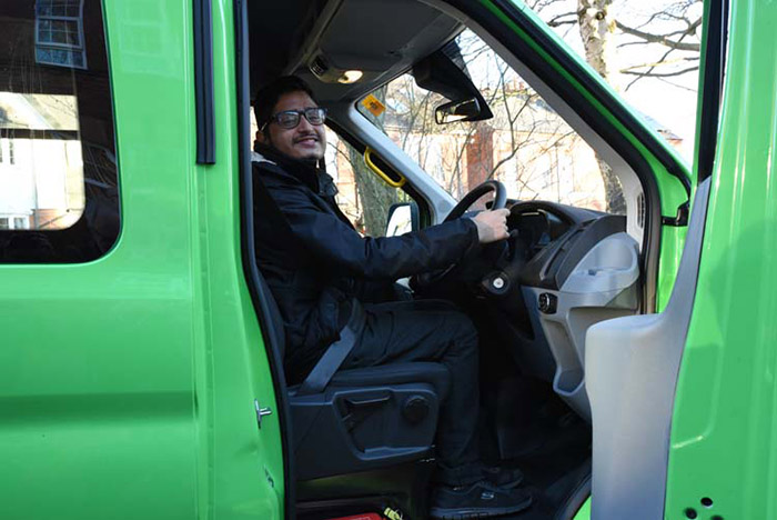 QAC student Pritesh in the drivers seat of the minibus