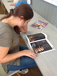 QAC student reads Baking Heaven Magazine