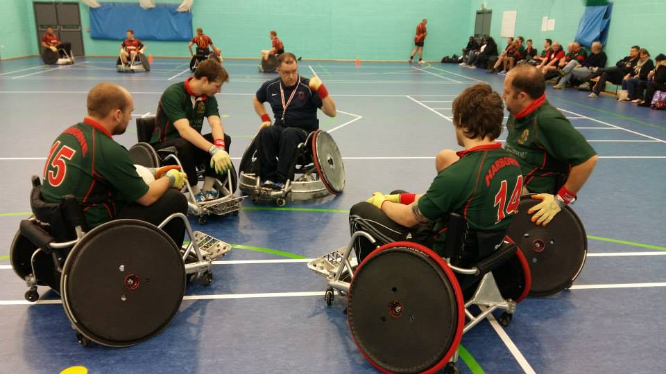 Players warm up before wheelchair rugby game