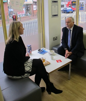 Sandwell Councillor Bob Piper and BBC Special Correspondent Katie Razzall sit at a table in  Coffee Junction and talk - Aug 2015