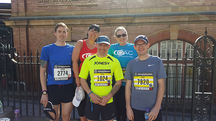 Team QAC runners all posing for a photo before the Great Birmingham Run