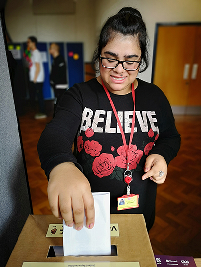 Female student casts her Student Council vote