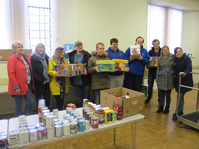 Students and staff posing for photo with their food parcels