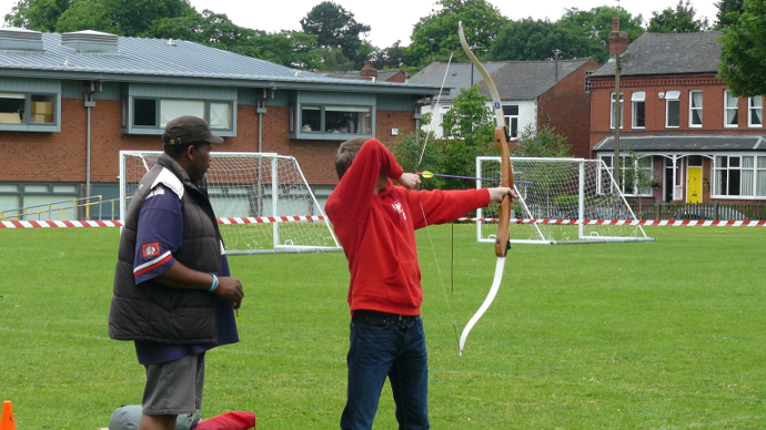 A person trying Archery during the Summer Fete