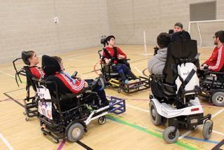 QAC Powerchair Football team grouped up prior to the game vs Telford