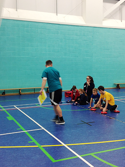 QAC Student helping to facilitate Birmingham South Primary Schools Boccia and Kurling Competition