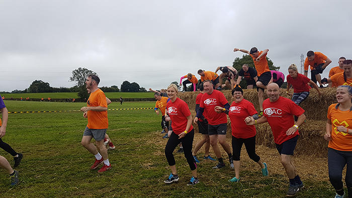 Runners tackling an obstacle during the Xrunner race
