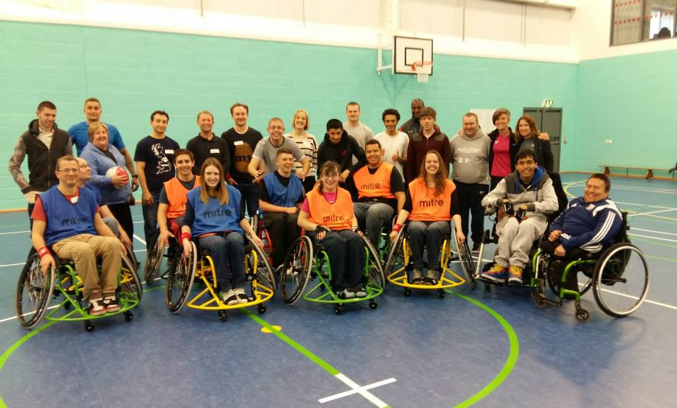 QAC Students and visitors from zurich insurance play wheelchair basketball