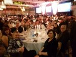 QAC staff sit around a table at the Tes FE Awards