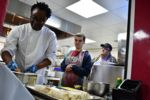 Chef Zeph demonstrates cooking method to students