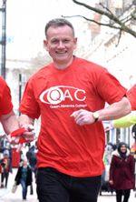 Dave Heeley running in a red QAC t-shirt