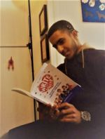 QAC student Abdullah reading a book