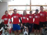 Staff and Students in QAC tshirts cycling