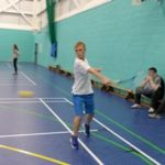 QAC student playing indoor tennis