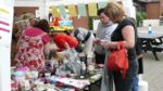 Group of people around a stall at the Summer Fete