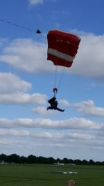 A Skydiver about to land after their jump