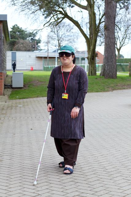 A female uses a carbon fibre revolution advantage long collapsible cane